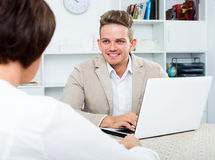 Journalist communicates with the wealthy woman. Male journalist communicates with the positive wealthy women in an informal situation Stock Image