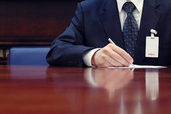Journalist is doing paperwork at the conference. Press concept, business concept Stock Photos