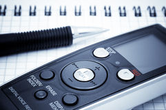Journalist equipment. Digital voice recorder, pen, notebook. Journalist equipment. Digital  voice recorder, pen and notebook Royalty Free Stock Photos