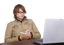 Journalist guy with laptop computer. One man journalist reporter taking notes looking at a laptop computer over white Stock Images