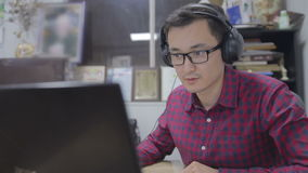 Journalist in the headphones writes the text for videonews stock video