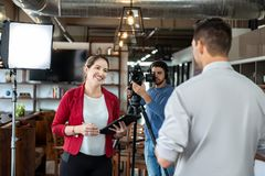 Journalist Interviewing Business Man In Conference Room For Broadcast stock photography