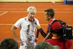 Journalist interviewing John McEnroe after a tennis match. Statements to the press of McEnroe after a tennis match of senior category Stock Image