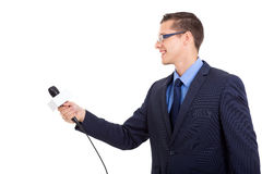 Journalist interviewing. Side view of journalist interviewing with microphone on white background Stock Image