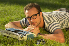 Journalist lying on the grass Stock Photography