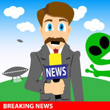 Journalist makes a report about aliens invasion. Stock Photo