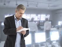 Journalist. Man journalist writing letter on the notepad Royalty Free Stock Photography