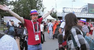Journalist and operator BBC among fans. RUSSIA, MOSCOW - June 27, 2018: Journalist and operator BBC among fans. Football fans of Serbia, Brazil, Russia before stock video footage