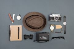 Journalist or private detective workplace - camera, hat, recorder and other stuff. Journalist or private detective workplace - notepad, camera, hat, recorder and royalty free stock image