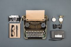Journalist or private detective workplace - typewriter, camera, recorder and other stuff. Flat view above royalty free stock photo