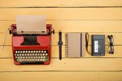 Journalist or private detective workplace - typewriter, recorder and other stuff on the yellow planks. Journalist or private detective workplace - typewriter royalty free stock image