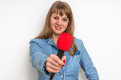 Journalist with red microphone making interview. Journalism and broadcasting concept Royalty Free Stock Image