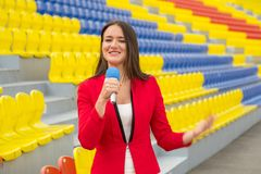 The journalist is reporting from the stadium Stock Image