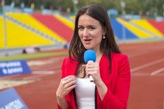 The journalist is reporting from the stadium. For television Stock Images