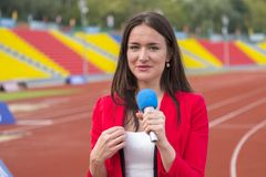The journalist is reporting from the stadium Royalty Free Stock Photos