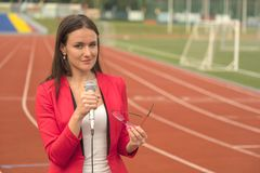 Journalist is reporting from the stadium for television Royalty Free Stock Photo