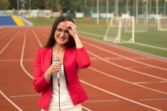 Journalist is reporting from the stadium for television Royalty Free Stock Image