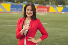 The journalist is reporting for television. The journalist is reporting from the stadium for television Stock Image