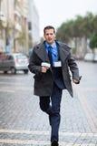 Journalist running street. Professional journalist running on urban street Royalty Free Stock Photos