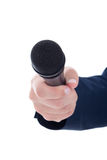 Journalist's hand holding a microphone isolated on white Royalty Free Stock Photography