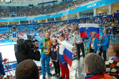 Journalist takes enterview Russian spectators Royalty Free Stock Photography
