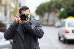 Journalist taking photos. Professional journalist taking photos outdoors Royalty Free Stock Image