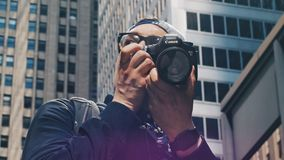 Journalist taking picture in the city Royalty Free Stock Photos