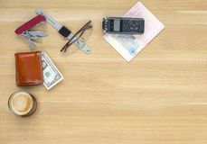 Journalist travel set on the table. Voice recorder, knife, wallet, banknotes, glasses Royalty Free Stock Images
