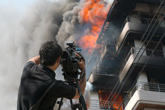 Journalist Video Compression fire brigade building. royalty free stock image