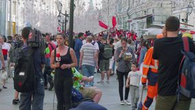 Journalists make report about fans from Tunisia in Moscow. Journalists make report about fans from Tunisia in Nikolskaya street in Moscow stock video footage