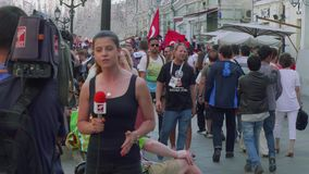 Journalists make report about fans from Tunisia in Moscow. Journalists make report about fans from Tunisia in Nikolskaya street in Moscow stock footage