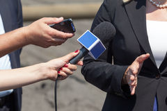 Journalists making interview with business woman Stock Photos