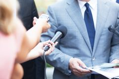 Journalists making media interview with business person or politician royalty free stock photography