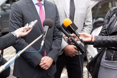 Journalists making media interview with businessman. Journalists making media interview with businessperson or politician Royalty Free Stock Photography