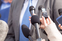 Journalists making media interview with businessperson or politician. Reporters making press interview with businessman or politician. News conference Royalty Free Stock Photos