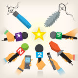 Journalists performing interview. Journalists hands holding microphones and dictophones performing interview Royalty Free Stock Images