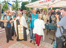 Journalists and priests at the opening of the festival of Orthodox music in Pomorie, Bulgaria. Pomorie - famous resort town in Bulgaria. In summer it is a royalty free stock photos