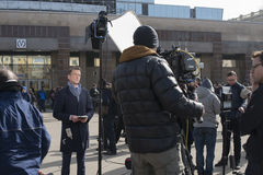 Journalists are reporting from the scene. Royalty Free Stock Images