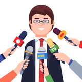 Journalists taking interview from a politician Royalty Free Stock Photo