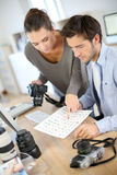 Journalists working in office. Photo reporters working in office Stock Photography