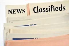 Journaux empilés de classifieds photographie stock