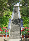 Journey of  a 100 steps with a single step. Steep staircase and steps  with running water by the side Stock Image