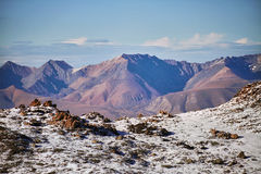 Journey through Altai mountains to Aktru. Hiking to snowy peaks of Altai mountains. Survival in harsh conditions, beautiful nature. Journey through the Altai royalty free stock image