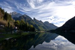 Lake Alleghe in Belluno, under the great Monte Civetta. Journey through the beauties of the city of Belluno in Italy, the pearl of the Dolomites Royalty Free Stock Images