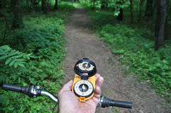 Journey by bike with a compass. Royalty Free Stock Images