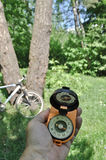 Journey by bike with a compass. Royalty Free Stock Photos