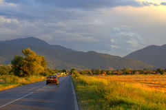 Journey. Car drive on road in summer beautiful scenery to high mountains Stock Photography