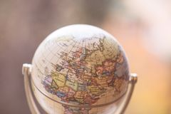Journey: Close up of a globe. Close up of an old vintage globe, blurry background travel earth transport journey world vacation planning liberty adventure royalty free stock photography
