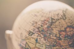 Journey: Close up of a globe. Close up of an old vintage globe, blurry background travel earth transport journey world vacation planning liberty adventure stock images