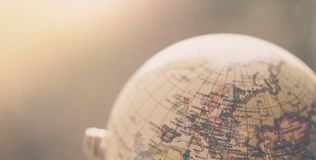 Journey: Close up of a globe. Close up of an old vintage globe, blurry background travel earth transport journey world vacation planning liberty adventure royalty free stock images